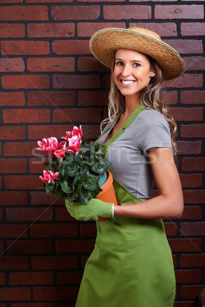 Woman with flowers Stock photo © Kurhan