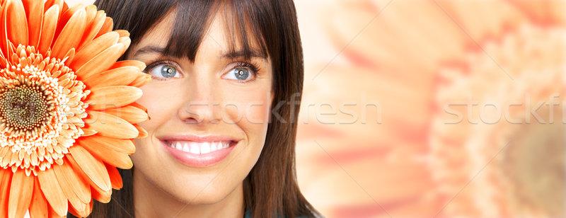 Mujer hermosa sonrisa flor hermosa dentales Foto stock © Kurhan