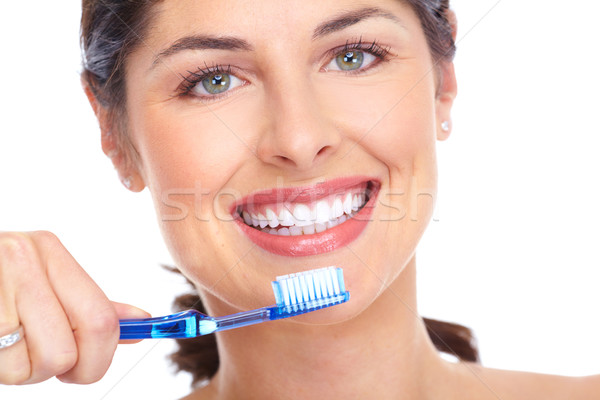 Happy woman with a toothbrush. Dental care. Stock photo © Kurhan