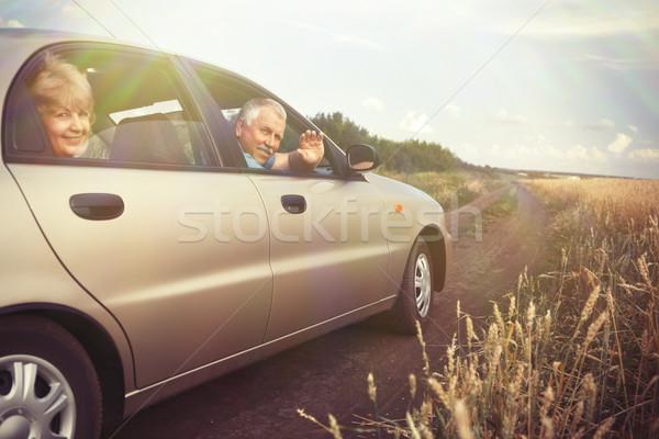 Twee ouderen mensen auto veld glimlach Stockfoto © Kurhan