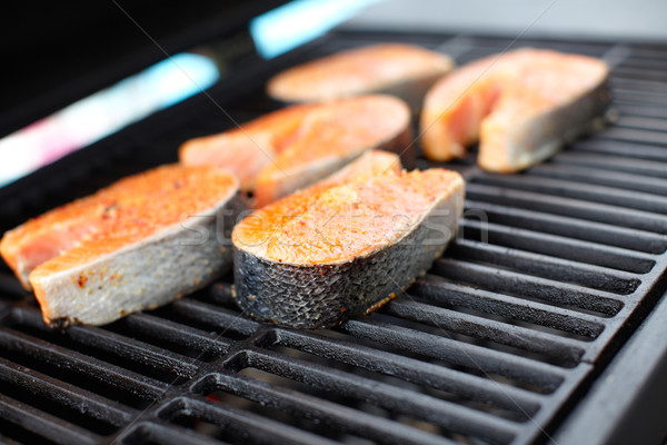 Stock photo: Salmon fish roast on barbecue grill.