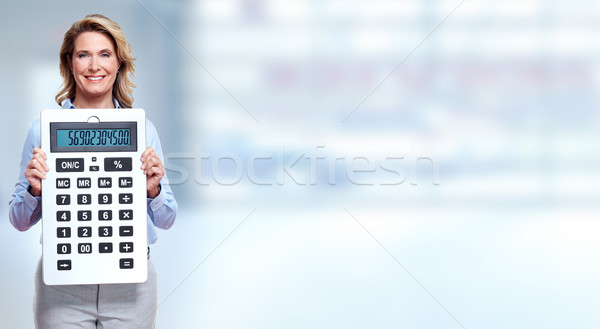 Accountant business woman with a calculator. Stock photo © Kurhan