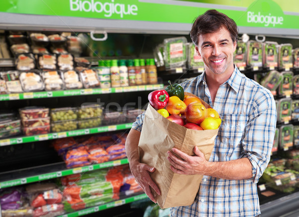 Man with grocery bag of vegetables. Stock photo © Kurhan