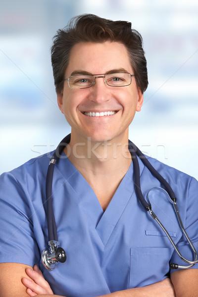 Smiling medical doctor man. Stock photo © Kurhan