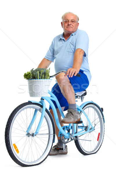 Stock photo: Elderly man with bicycle and vegetables.