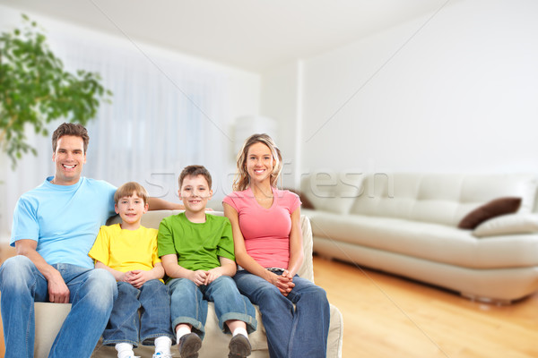 Happy family in a new house. Stock photo © Kurhan