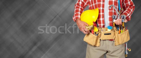 配管 手 ヘルメット 給水栓 黒 男 ストックフォト © Kurhan