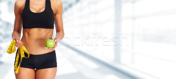 Mujer abdomen cinta métrica manzana dieta Foto stock © Kurhan