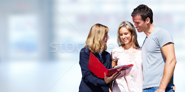 Real Estate agent woman with clients. Stock photo © Kurhan