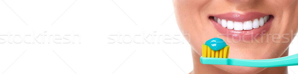 Száj fogkefe fiatal mosolyog lány fogmosás Stock fotó © Kurhan