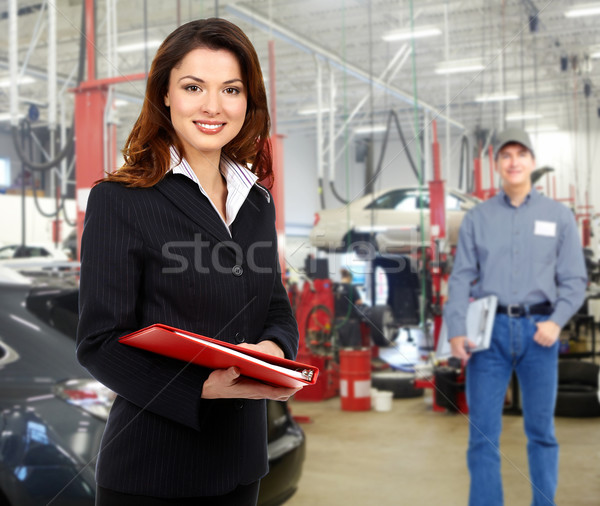 Stock photo: Woman manager in auto repair service.