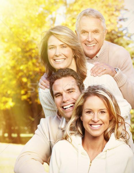 Boldog család portré boldog mosolyog család megnyugtató Stock fotó © Kurhan