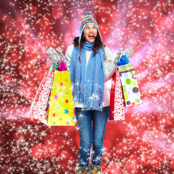 Girl with shopping bags over Xmas background. Stock photo © Kurhan