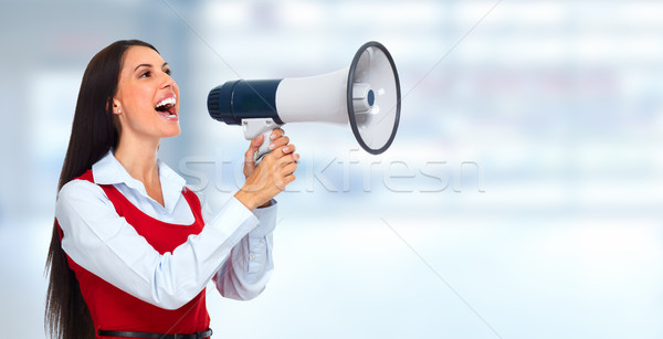 Young woman with loudspeaker. Stock photo © Kurhan