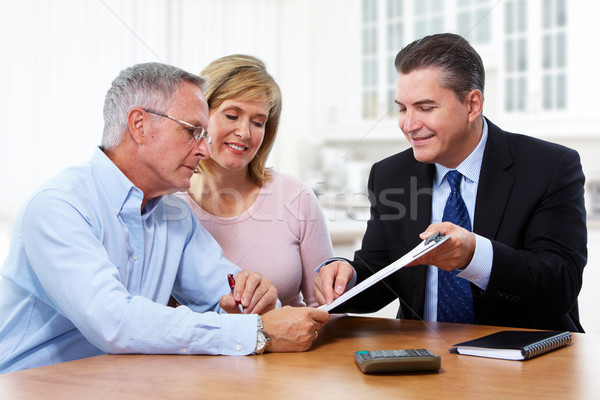 Senior couple with insurance agent. Stock photo © Kurhan