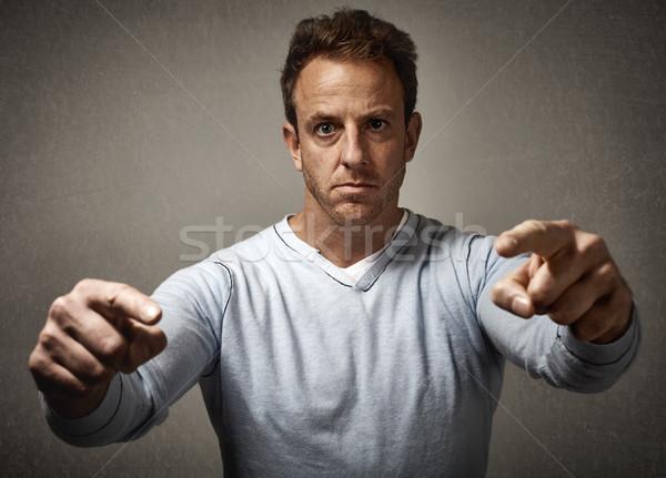 Man pointing to the camera. Stock photo © Kurhan