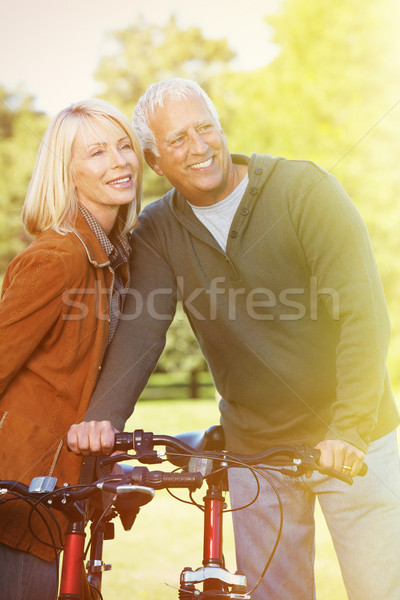 Old people with bycicle Stock photo © Kurhan
