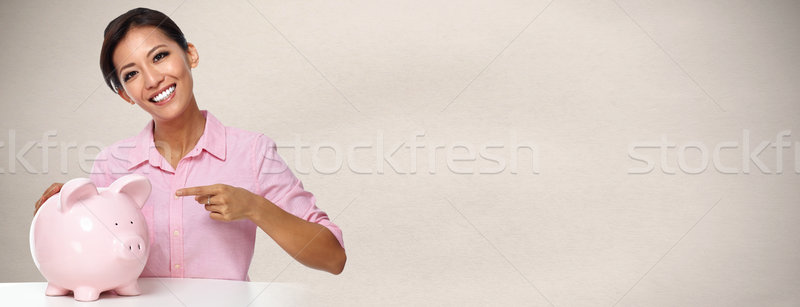 Young asian woman with a piggy bank. Stock photo © Kurhan
