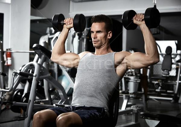 плечо скамейке прессы тренировки сильный молодым человеком Сток-фото © Kurhan