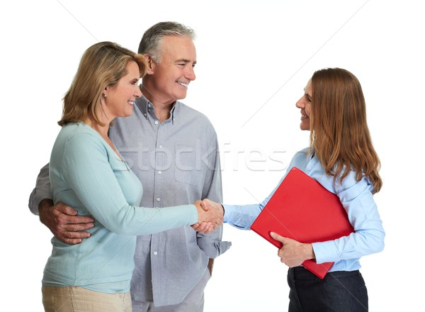 Senior couple with realtor. Stock photo © Kurhan