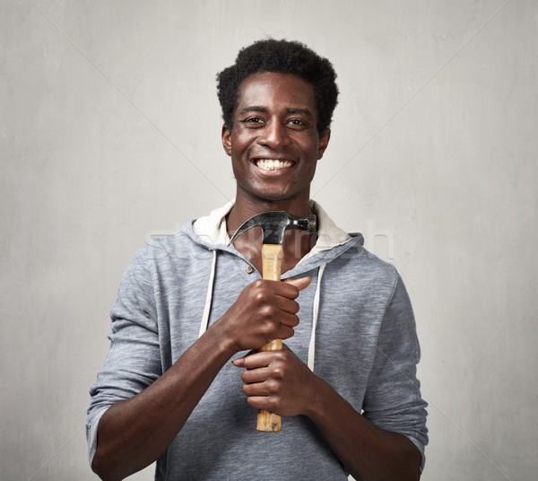 Stock photo: Black man with hammer