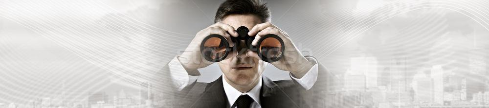 Businessman with binoculars. Stock photo © Kurhan