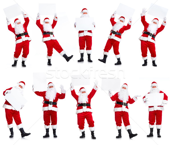 Group of Christmas Santa Claus with poster. Stock photo © Kurhan