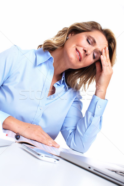 Business woman having a headache. Stock photo © Kurhan