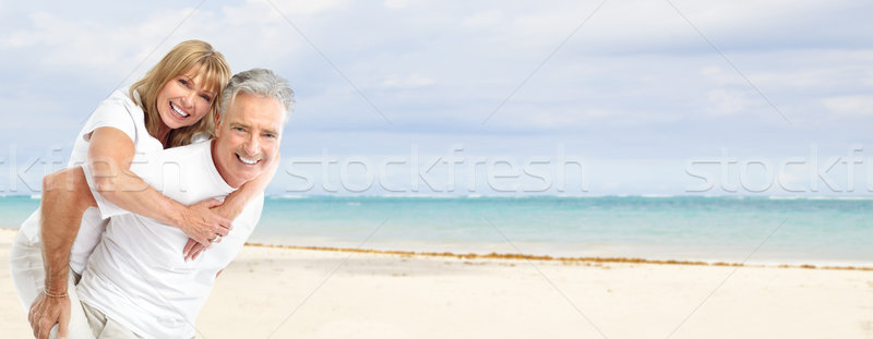 Happy senior couple on the beach. Stock photo © Kurhan