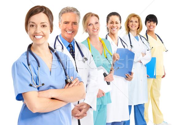 Médicos sonriendo médicos aislado blanco trabajo Foto stock © Kurhan