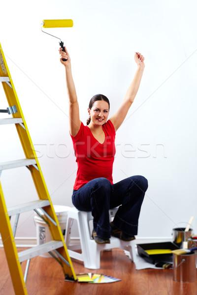 Beautiful woman with painting roller. Stock photo © Kurhan