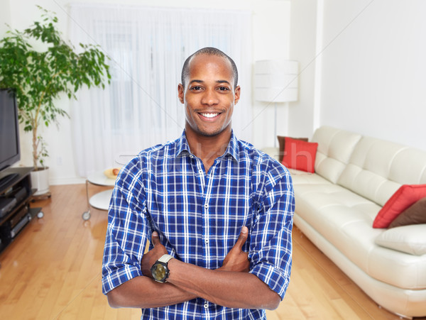 African-american man in new apartment. Stock photo © Kurhan