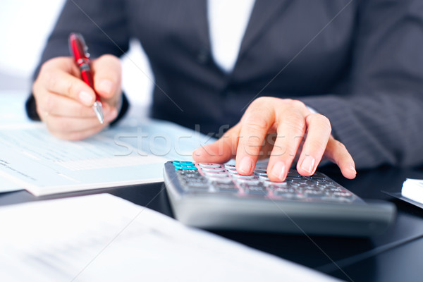 Hands of accountant business woman with calculator. Stock photo © Kurhan