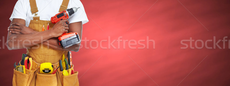 Worker man with a drill. Stock photo © Kurhan