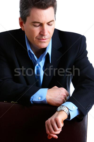 Stipt zakenman knap naar horloge gelukkig Stockfoto © Kurhan