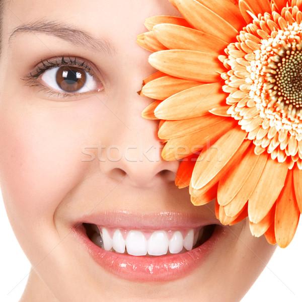 женщину цветок красивой улыбаясь изолированный Сток-фото © Kurhan
