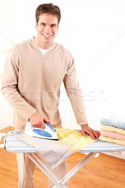 Tareas de la casa feliz jóvenes hombre guapo ropa Foto stock © Kurhan
