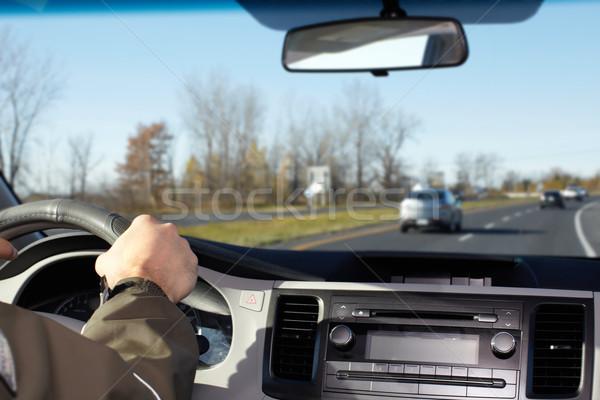 Hand of man driving on a highway. Stock photo © Kurhan