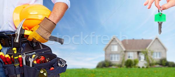 Builder handyman with construction tools. Stock photo © Kurhan