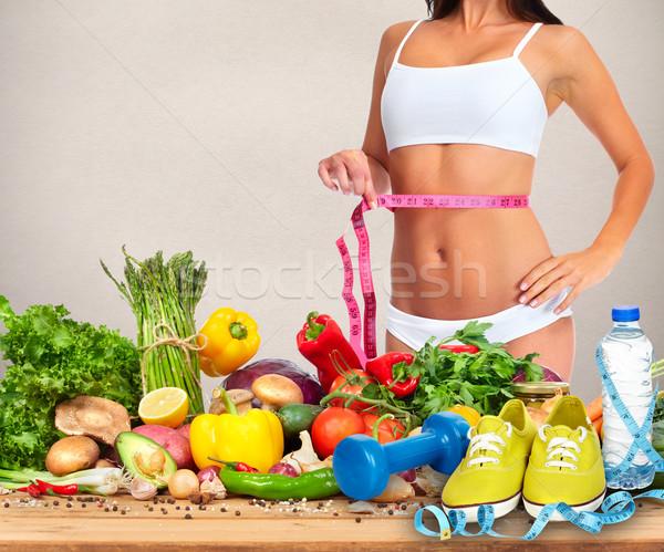 Mujer cintura cinta métrica alimentos abdomen Foto stock © Kurhan