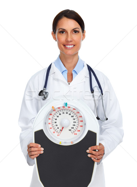 Young medical doctor woman with scales. Stock photo © Kurhan