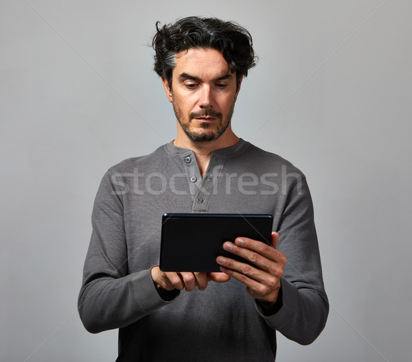 Man with tablet computer Stock photo © Kurhan