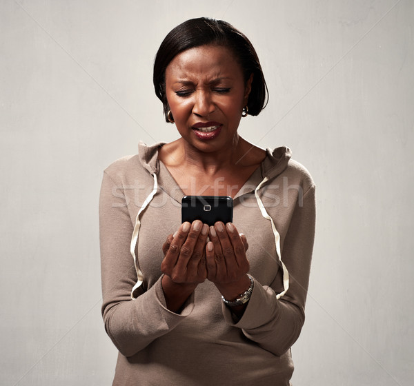 discontented woman with smartphone Stock photo © Kurhan