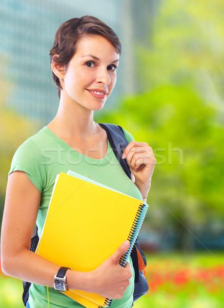 Fiatal diák nő mosolyog könyv egyetem Stock fotó © Kurhan