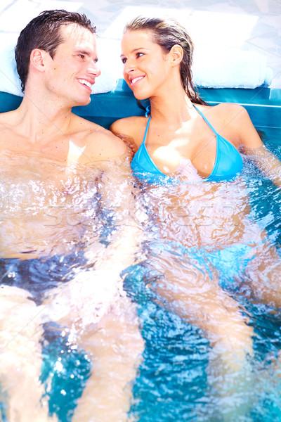 Jacuzzi jovem casal estância termal Foto stock © Kurhan