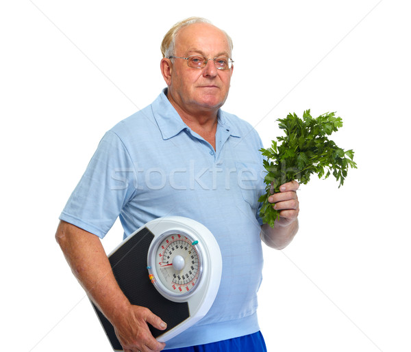 Senior man with scales and parsley. Stock photo © Kurhan