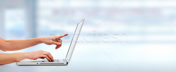 Hands with laptop computer. Stock photo © Kurhan