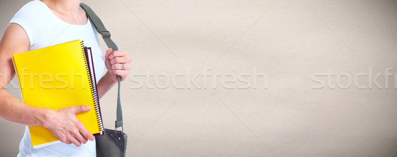 Hands of young student girl with a book. Stock photo © Kurhan