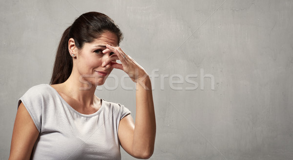Girl disgusted face expression Stock photo © Kurhan