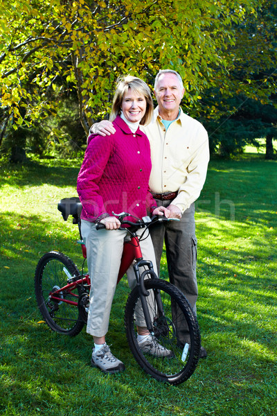 Stock photo: Senior couple cycling